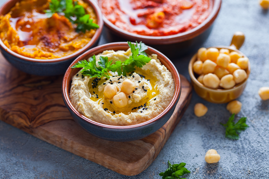 One of the holiday food swaps on our list is trading creamy snack dips for hummus.