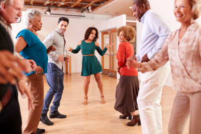 One of the health benefits of dancing for seniors is that it improves strength and balance.